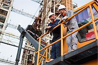 platform - Workers talking at oil refinery Stock Photo - Premium Royalty-Freenull, Code: 649-06040434
