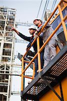 platform - Workers talking at oil refinery Stock Photo - Premium Royalty-Freenull, Code: 649-06040435