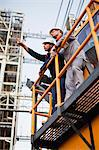 Workers talking at oil refinery Stock Photo - Premium Royalty-Free, Artist: Marc Simon, Code: 649-06040435
