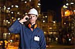 Worker on cell phone at oil refinery Stock Photo - Premium Royalty-Free, Artist: Marc Simon, Code: 649-06040447