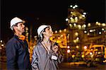 Workers talking at oil refinery Stock Photo - Premium Royalty-Free, Artist: Marc Simon, Code: 649-06040448