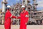Workers shaking hands at oil refinery Stock Photo - Premium Royalty-Freenull, Code: 649-06040450