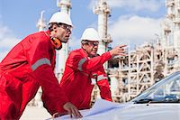 refinery - Workers with blueprints at oil refinery Stock Photo - Premium Royalty-Freenull, Code: 649-06040455
