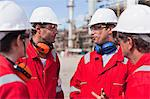 Workers talking at oil refinery Stock Photo - Premium Royalty-Free, Artist: Marc Simon, Code: 649-06040457