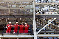 platform - Workers standing on ledge together Stock Photo - Premium Royalty-Freenull, Code: 649-06040463