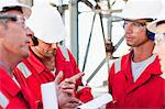 Workers talking at oil refinery Stock Photo - Premium Royalty-Free, Artist: Marc Simon, Code: 649-06040472