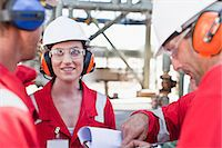 refinery - Workers talking at oil refinery Stock Photo - Premium Royalty-Freenull, Code: 649-06040473