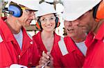 Workers talking at oil refinery Stock Photo - Premium Royalty-Free, Artist: Marc Simon, Code: 649-06040474
