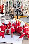 Workers with blueprints at oil refinery Stock Photo - Premium Royalty-Free, Artist: Marc Simon, Code: 649-06040475