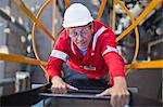 Worker climbing ladder at oil refinery Stock Photo - Premium Royalty-Free, Artist: Marc Simon, Code: 649-06040484