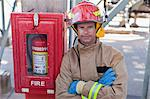 Firefighter smiling on site Stock Photo - Premium Royalty-Free, Artist: Marc Simon, Code: 649-06040489