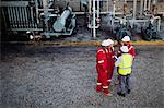 Workers talking at chemical plant Stock Photo - Premium Royalty-Free, Artist: Marc Simon, Code: 649-06040547