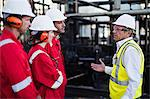 Workers talking at chemical plant Stock Photo - Premium Royalty-Free, Artist: Marc Simon, Code: 649-06040553