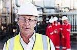 Worker standing at chemical plant Stock Photo - Premium Royalty-Free, Artist: Marc Simon, Code: 649-06040556