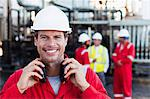 Worker standing at chemical plant Stock Photo - Premium Royalty-Free, Artist: Marc Simon, Code: 649-06040558