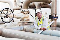 refinery - Worker on pipes at chemical plant Stock Photo - Premium Royalty-Freenull, Code: 649-06040562