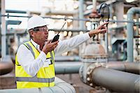 refinery - Worker using walkie talkie on site Stock Photo - Premium Royalty-Freenull, Code: 649-06040563