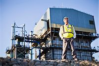 refinery - Worker standing at chemical plant Stock Photo - Premium Royalty-Freenull, Code: 649-06040565