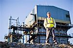 Worker standing at chemical plant Stock Photo - Premium Royalty-Free, Artist: Marc Simon, Code: 649-06040565