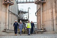 refinery - Workers walking at chemical plant Stock Photo - Premium Royalty-Freenull, Code: 649-06040576
