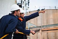 refinery - Workers talking at chemical plant Stock Photo - Premium Royalty-Freenull, Code: 649-06040580