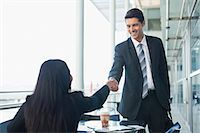 Business people shaking hands in cafe Stock Photo - Premium Royalty-Freenull, Code: 649-06040603