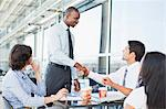 Business people shaking hands in cafe Stock Photo - Premium Royalty-Free, Artist: Blend Images, Code: 649-06040612