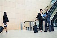 Business people talking in lobby Stock Photo - Premium Royalty-Freenull, Code: 649-06040625