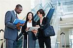 Business people talking in lobby Stock Photo - Premium Royalty-Free, Artist: Masterfile, Code: 649-06040627