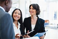 Business people talking in lobby Stock Photo - Premium Royalty-Freenull, Code: 649-06040628