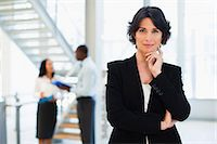 Businesswoman smiling in office Stock Photo - Premium Royalty-Freenull, Code: 649-06040629