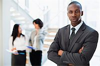 Businessman standing in office Stock Photo - Premium Royalty-Freenull, Code: 649-06040630