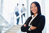 Businesswoman smiling in office Stock Photo - Premium Royalty-Freenull, Code: 649-06040633