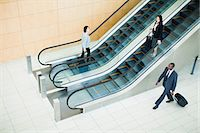 Business people in lobby area Stock Photo - Premium Royalty-Freenull, Code: 649-06040636