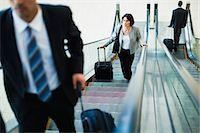 Business people riding escalator Stock Photo - Premium Royalty-Freenull, Code: 649-06040640