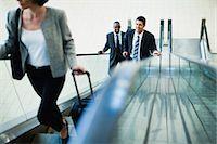 Business people riding escalator Stock Photo - Premium Royalty-Freenull, Code: 649-06040641