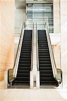 Empty escalators in lobby Stock Photo - Premium Royalty-Freenull, Code: 649-06040644