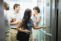 Business people riding glass elevator Stock Photo - Premium Royalty-Freenull, Code: 649-06040670