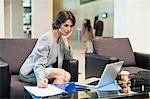Businesswoman working in lobby Stock Photo - Premium Royalty-Free, Artist: James Wardell, Code: 649-06040695