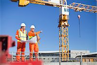 Workers reading blueprints on site Stock Photo - Premium Royalty-Freenull, Code: 649-06040712