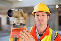 Worker using equipment on site Stock Photo - Premium Royalty-Freenull, Code: 649-06040733