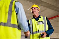 Workers shaking hands on site Stock Photo - Premium Royalty-Freenull, Code: 649-06040766