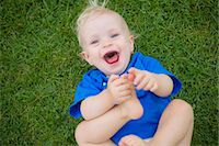 Baby boy playing with his feet Stock Photo - Premium Royalty-Freenull, Code: 649-06040834
