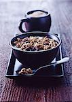 Bowl of granola on tray Stock Photo - Premium Royalty-Free, Artist: Photocuisine, Code: 649-06040871