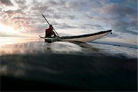 Man kayaking on still lake Stock Photo - Premium Royalty-Freenull, Code: 649-06040975