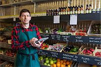Grocer using tablet computer in store Stock Photo - Premium Royalty-Freenull, Code: 649-06041012