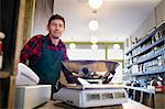 Grocer working behind counter at store Stock Photo - Premium Royalty-Free, Artist: Noel Hendrickson, Code: 649-06041029