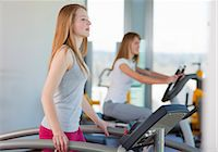 Girl using treadmill in gym Stock Photo - Premium Royalty-Freenull, Code: 649-06041065