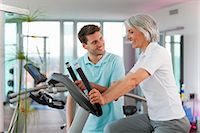 fitness older women gym - Trainer working with woman in gym Stock Photo - Premium Royalty-Freenull, Code: 649-06041096