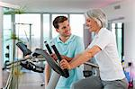 Trainer working with woman in gym Stock Photo - Premium Royalty-Free, Artist: Blend Images, Code: 649-06041096